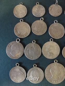 29 x SMALL WORLD SILVER COINS, MOUNTED AS CHARMS, PLUS A MINIATURE CRIMEA MEDAL