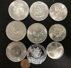 Lot of 9 Large Silver World Coins